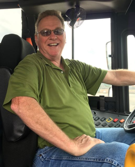 Mr. Wally At The Wheel Of His School Bus – Ready To Roll.